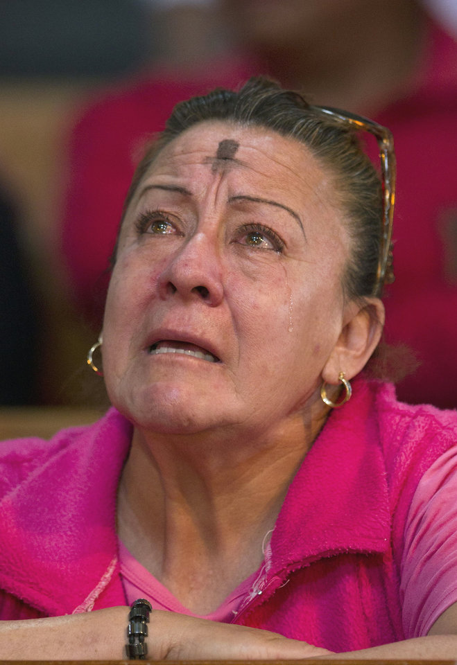A woman, marked with an ash cross on her forehead that signifies repentance, weeps as she prays during Ash Wednesday services at the Metropolitan Cathedral in Mexico City, Wednesday Feb. 22, 2012. Ash Wednesday for Christians worldwide ushers in a period of penitence and reflection, known as the season of Lent, that leads up to Easter Sunday. (AP Photo/Eduardo Verdugo)
