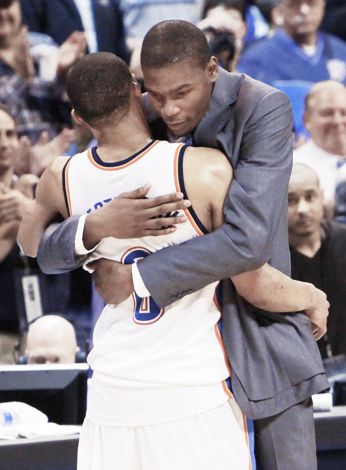 Photo - The Thunder's Kevin Durant hugs Russell Westbrook after Oklahoma City's 96-87 win over the Dallas Mavericks on Monday. Westbrook had a triple-double with both Durant and Jeff Green out with injuries. Photo by Nate Billings, The Oklahoman