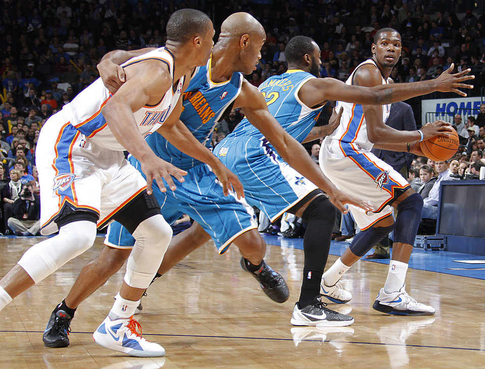 Oklahoma City Thunder small forward Kevin Durant (35) looks to pass the ball past New Orleans Hornets forward DaJuan Summers (22) during the NBA basketball game between the Oklahoma City Thunder and the New Orleans Hornets at the Chesapeake Energy Arena on Wednesday, Jan. 25, 2012, in Oklahoma City, Okla. Photo by Chris Landsberger, The Oklahoman