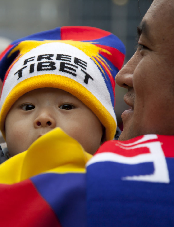 A young child with a 'Free Tibet' hat waits in a group prior to a march of Tibetans and their supporters during a demonstration in Brussels on Sunday, March 10, 2013. The Europe-wide rally by Tibetans and Tibet supporters was held in Brussels on Sunday to mark the 54th anniversary of Tibet�s national uprising. (AP Photo/Virginia Mayo)