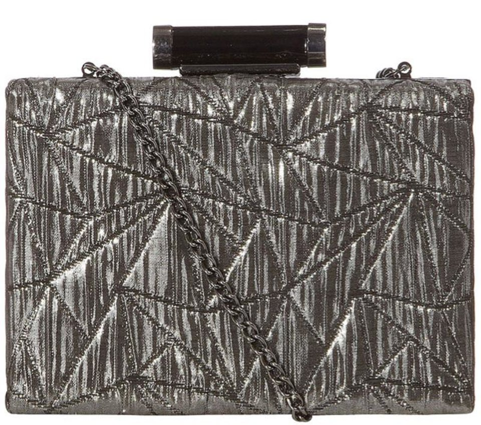 """While striking pose after pose at events to promote the newly released """"Les Miserables,"""" Anne Hathaway has captivated her fans in designs that are edgy, fashion forward and refreshingly different. For a similar look try this silver shimmer box clutch ($27 from DorothyPerkins.com). (Los Angeles Times/MCT)"""