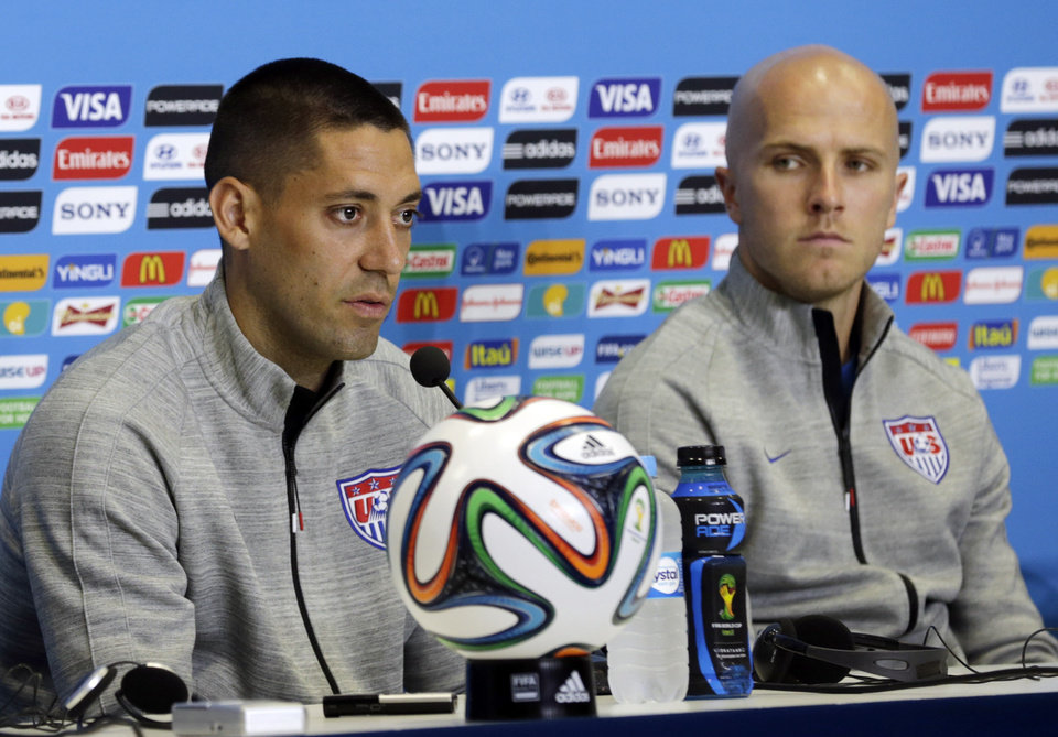 Photo - United States' Clint Dempsey, left, and Michael Bradley attend a press conference before an official training session the day before the group G World Cup soccer match between Ghana and the United States at the Arena das Dunas in Natal, Brazil, Sunday, June 15, 2014. (AP Photo/Dolores Ochoa)