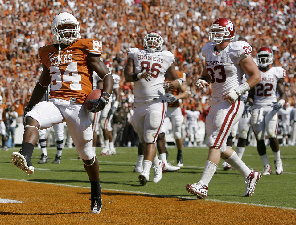 Photo - Marquise Goodwin of Texas scores a touchdown in front of OU's Adrian Taylor and Auston English at right, during the Red River Rivalry college football game between the University of Oklahoma Sooners (OU) and the University of Texas Longhorns (UT) at the Cotton Bowl in Dallas, Texas, Saturday, Oct. 17, 2009. Photo by Bryan Terry, The Oklahoman