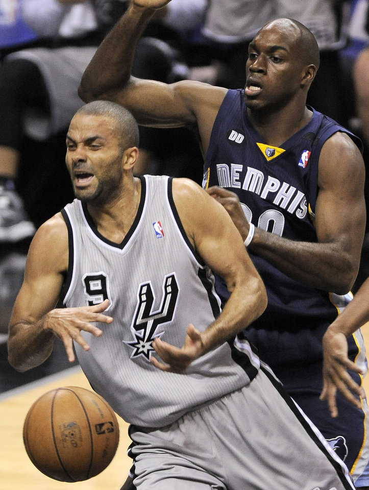 Photo - San Antonio Spurs' Tony Parker, left, of France, is fouled as he drives around Memphis Grizzlies' Quincy Pondexter during the first half of Game 1 of the Western Conference final NBA basketball playoff series, Sunday, May 19, 2013, in San Antonio. (AP Photo/Darren Abate)