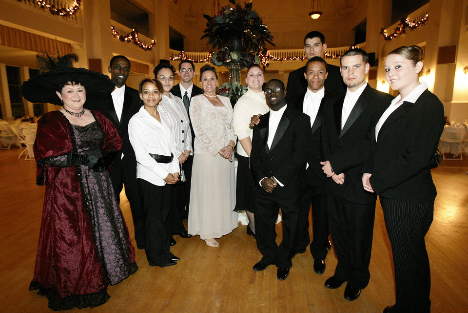 Photo - Volunteers from the Guthrie Job Corps pose for a photo with Job Corps Coordinator Sharon DeVeau, center, and Joy Newton, left,  the Oklahoma Centennial Statehood Inaugural Ball, Saturday, Nov. 17, 2007, at the Guthrie Scottish Rite Masonic Center, in Guthrie, Okla. The students help as servers at the ball. By Bill Waugh, The Oklahoman