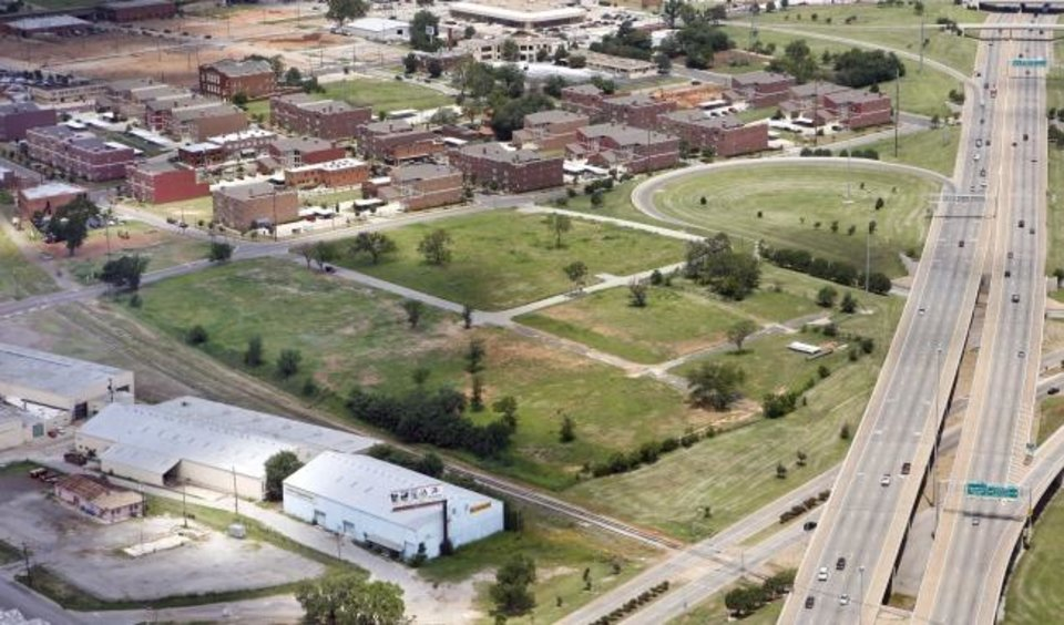 Photo -  Hundreds of apartments, stores and the Aloft Hotel in Deep Deuce and the Steelyard in Bricktown had yet to be conceived or built when Bill Canfield was awarded development of The Hill as shown in this 2006 aerial photo. [THE OKLAHOMAN ARCHIVES]