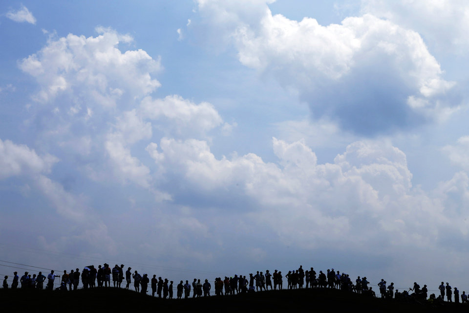 Photo - Fans line the fourth fairway to watch Tiger Woods during a practice round for the PGA Championship golf tournament at Valhalla Golf Club on Wednesday, Aug. 6, 2014, in Louisville, Ky. The tournament is set to begin on Thursday. (AP Photo/John Locher)