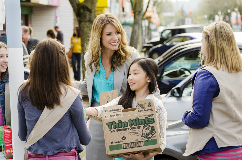 Successful realtor Julie Sterling (Jessalyn Gilsig, center) was initially reluctant to lead a Girl Scout troop, but soon puts her expert sales skills to good use to help Paris (Melody Choi, front) and her fellow scouts compete in their annual cookie drive. Photo by Crown Media Holdings <strong>Chris Large</strong>