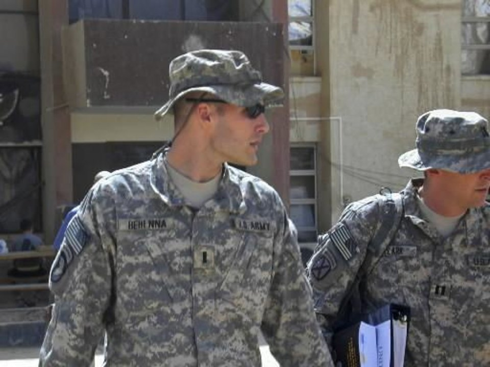 Photo - 2008 file photo - 1st Lt. Michael C. Behenna, left, and his defense attorney Capt. Tom Clark, right, walk in Camp Speicher, a large U.S. base near Tikrit, north of Baghdad, Iraq, Sunday, Sept. 21, 2008. (AP Photo/Vanessa Gera)