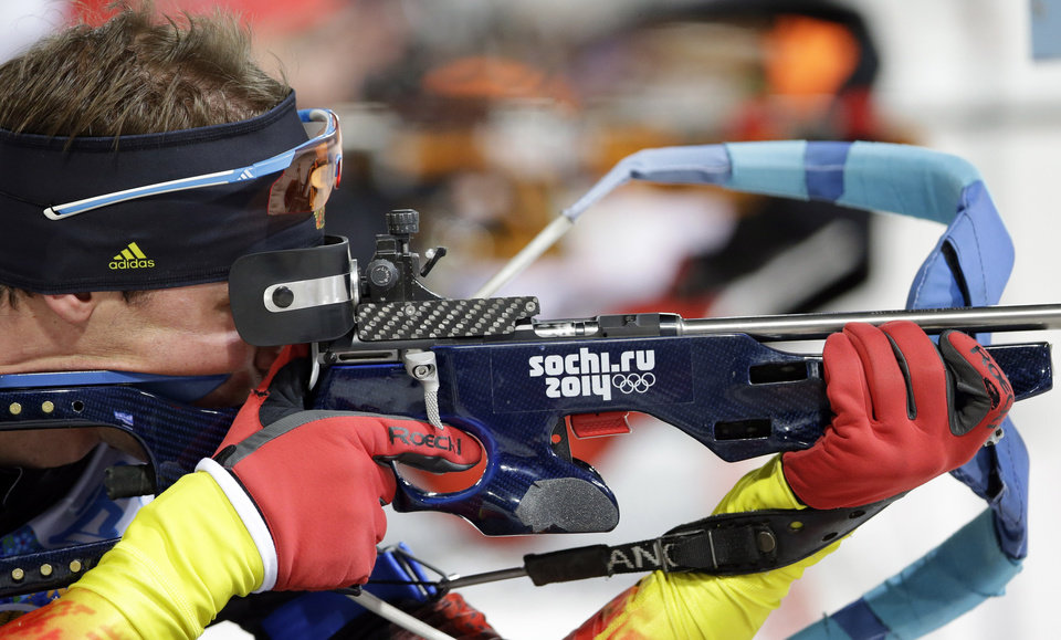 Photo - Germany's Simon Schempp shoots during the men's biathlon 4x7.5K relay at the 2014 Winter Olympics, Saturday, Feb. 22, 2014, in Krasnaya Polyana, Russia. (AP Photo/Lee Jin-man)