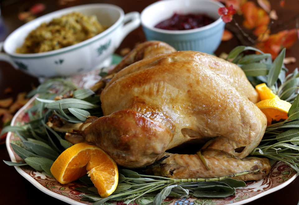 Photo - Turkey is the Thanksgiving dinner centerpiece.  Photo by Sarah Phipps, The Oklahoman  SARAH PHIPPS - SARAH PHIPPS