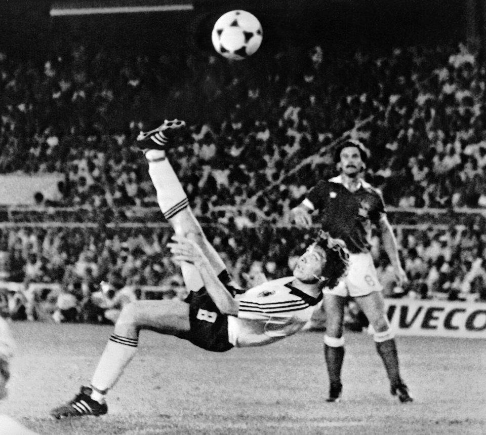 Photo - FILE - In this July 8, 1982 file photo, West Germany's Klaus Fischer scores the third goal and equalizes, in the World Cup semi-final soccer match against France, in Seville, Spain. On this day: West Germany defeats France in a penalty shoot out after a 3-3 draw. The game was marred by a terrible injury to France's Patrick Battiston following a collision with German goalkeeper Harald Schumacher.  (AP Photo/File)