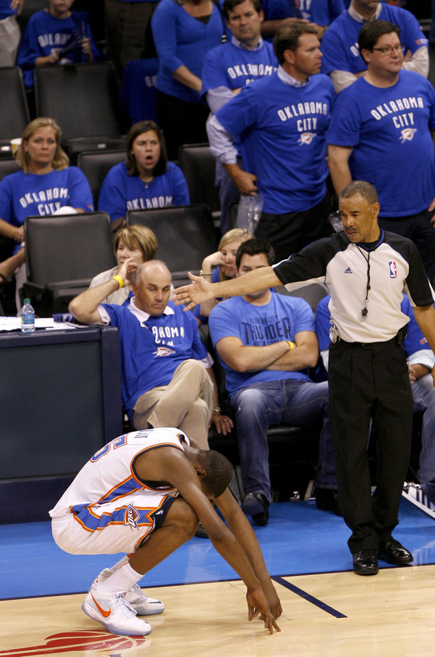 Photo - Oklahoma City's Kevin Durant (35) sits on the court in overtime of game 4 of the Western Conference Finals in the NBA basketball playoffs between the Dallas Mavericks and the Oklahoma City Thunder at the Oklahoma City Arena in downtown Oklahoma City, Monday, May 23, 2011. Dallas won in overtime, 112-105. Photo by Bryan Terry, The Oklahoman