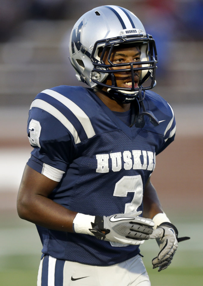 Edmond North\'s Curtis Woods walks back to the sidelines after a play during high school football game against Putnam City North at Wantland Stadium in Edmond, Okla., Friday, September 21, 2012. Photo by Bryan Terry, The Oklahoman