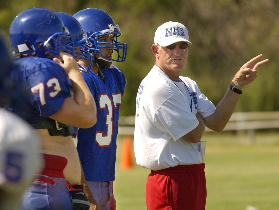 Moore head football coach Tom Noles gives instructions to his players during practice at Moore High School in 2002. Staff photo by Nate Billings, The Oklahoman Archives.