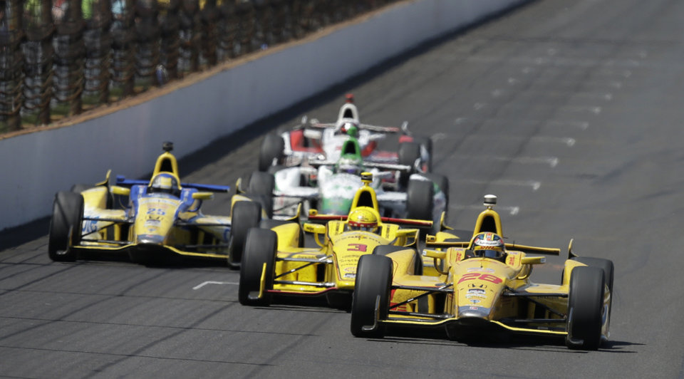 Photo - Ryan Hunter-Reay (28) takes the lead from Helio Castroneves, of Brazil, on the white flag lap during the Indianapolis 500 IndyCar auto race at Indianapolis Motor Speedway in Indianapolis, Sunday, May 25, 2014. Hunter-Reay went on to win the race. (AP Photo/Darron Cummings)