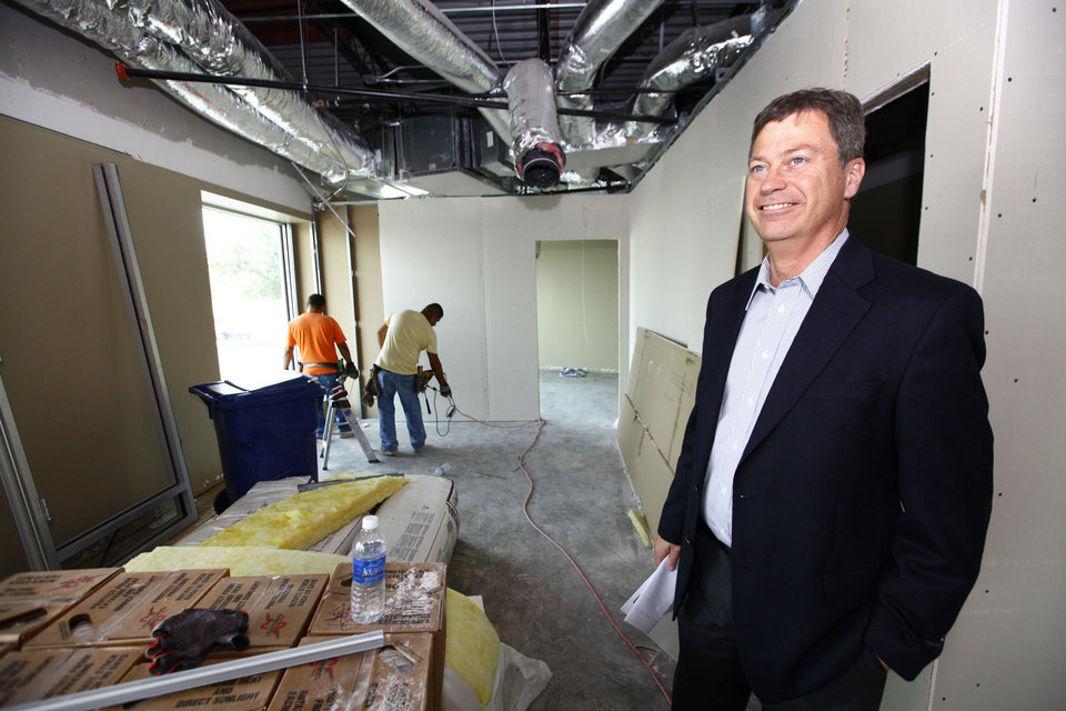 Photo - Jeff Smith, president and CEO of PrimeSource Mortgage, looks at renovations of space it is expand into at Founders Tower. The company moved here from Roswell, N.M., in August 2012.  David McDaniel - The Oklahoman