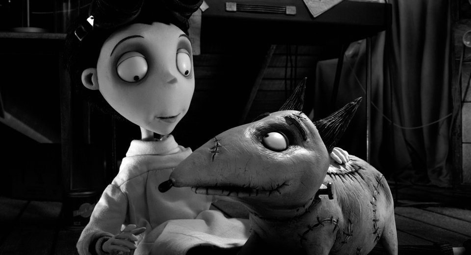 Photo -   This film image released by Disney shows Victor Frankenstein, voiced by Charlie Tahan, with Sparky, in a scene from