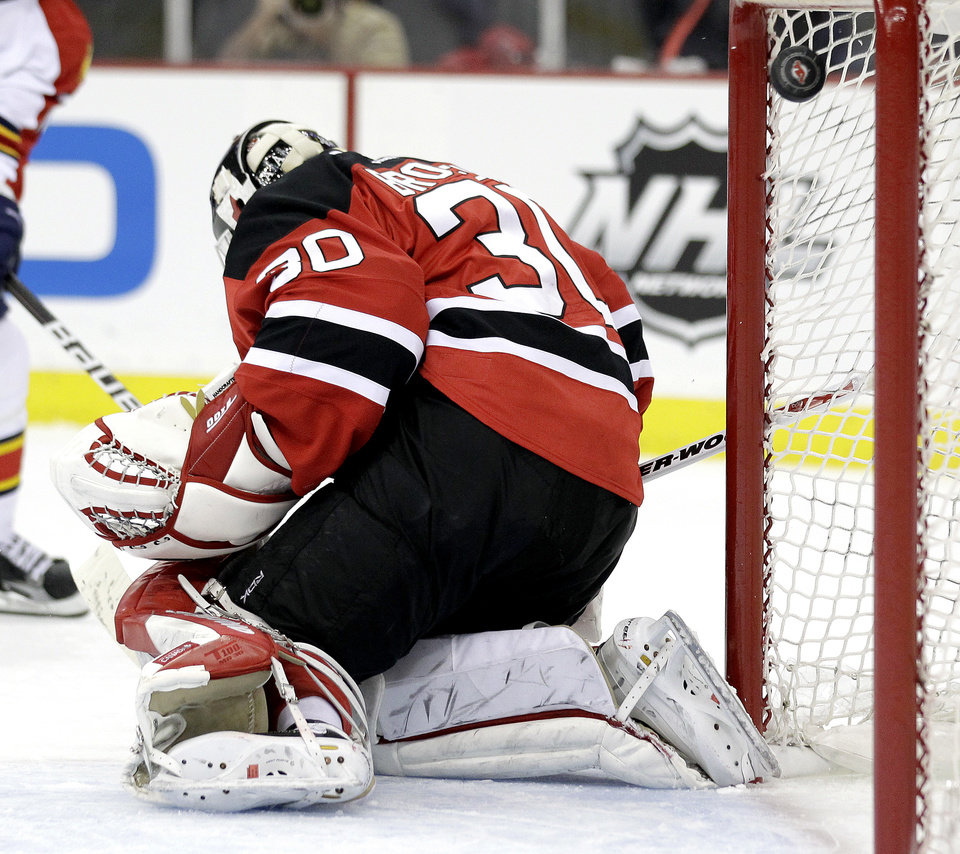 Photo -   New Jersey Devils' Martin Brodeur is unable to stop a goal by Florida Panthers' Sean Bergenheim during the first period of Game 3 of a first-round NHL hockey Stanley Cup playoff series, Tuesday, April 17, 2012, in Newark, N.J. (AP Photo/Julio Cortez)