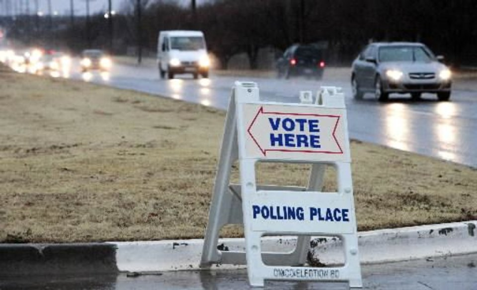 Photo - Vote Here sign at Holy Trinity Lutheran Church in Edmond, Tuesday, February 12, 2013. Photo By David McDaniel