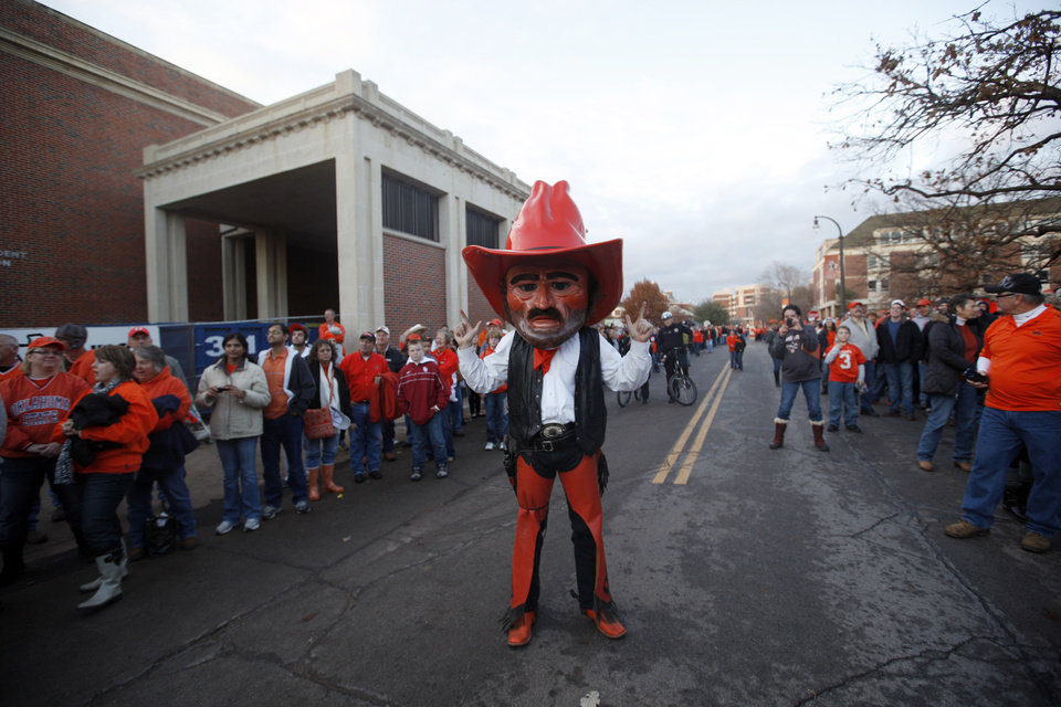 Photo - Pistol Pete warms up the crowd before the Bedlam college football game between the Oklahoma State University Cowboys (OSU) and the University of Oklahoma Sooners (OU) at Boone Pickens Stadium in Stillwater, Okla., Saturday, Dec. 3, 2011. Photo by Sarah Phipps, The Oklahoman