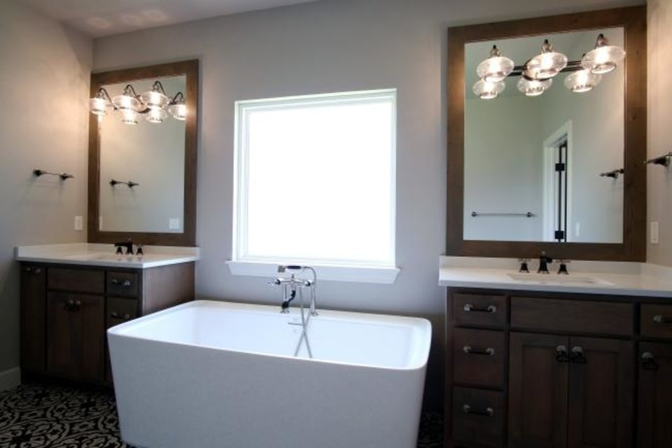 Photo -  Master bath with tub and double sinks in the St. Jude Dream Home. [DOUG HOKE/THE OKLAHOMAN]