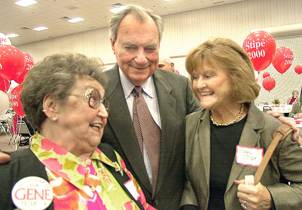 Photo - Former state Sen. Gene Stipe, D-McAlester, center, and his wife Mary, right, talk with with Gertrude Duncan, left, during the