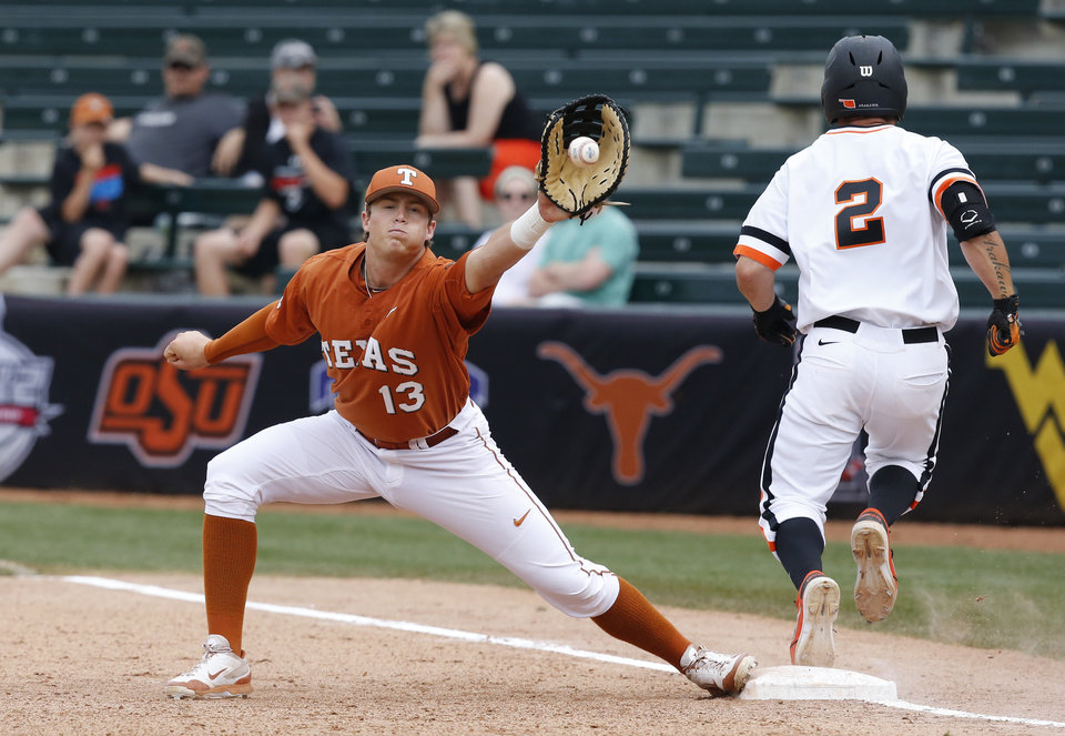 Photo - Oklahoma State's Tim Arakawa (2) is safe at first base as Texas first baseman Kacy Clemens (13) receives the ball in the second inning of a semifinal in the Big 12 NCAA college baseball tournament in Oklahoma City, Saturday, May 24, 2014. AP Photo/Sue Ogrocki)
