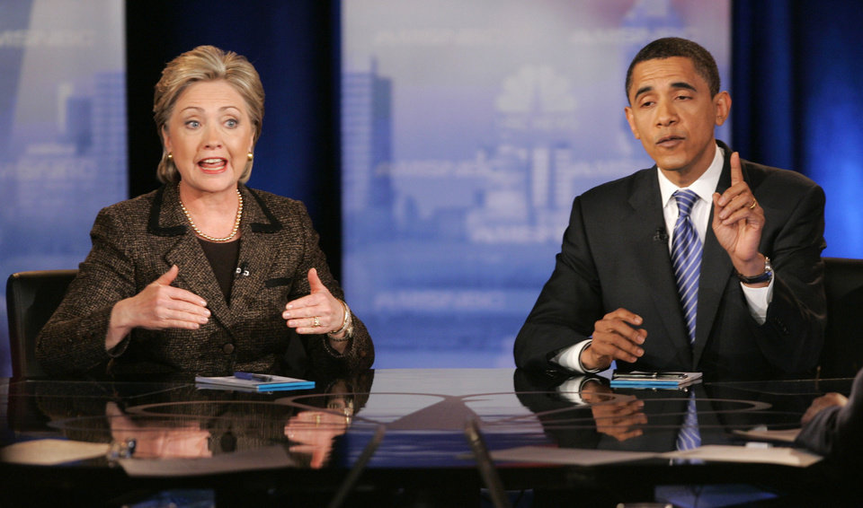 Photo -   FILE - In this Feb. 26, 2008, file photo, then Democratic presidential hopefuls Sen. Hillary Rodham Clinton, D-N.Y., left, and Sen. Barack Obama, D-Ill., respond to a question during a Democratic presidential debate in Cleveland. Mitt Romney pulled the plug on his first presidential run on Feb. 7, 2008, and immediately served notice that he wasn't about to fade away.