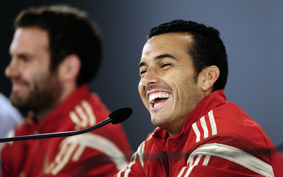Photo - Spain's Pedro Rodriguez, foreground, and Juan Mata smile, during a press conference at the Atletico Paranaense training center in Curitiba, Brazil, Monday, June 16, 2014. Spain will play Chile in group B World Cup soccer match on Wednesday. (AP Photo/Manu Fernandez)