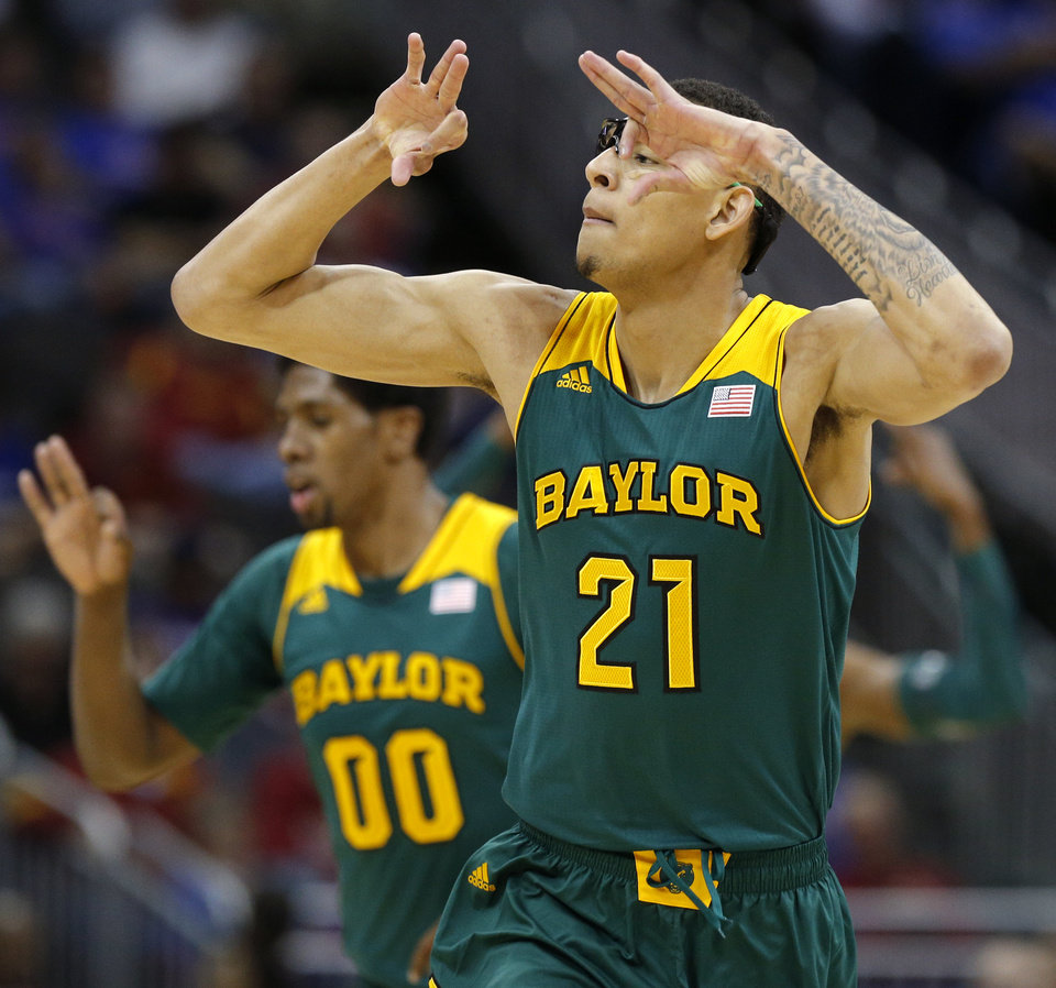 Photo - Baylor's Isaiah Austin (21) celebrates after a basket during the Big 12 Tournament college basketball game between the University of Oklahoma and Baylor at the Sprint Center in Kansas City, Mo., Thursday, March 13, 2014. Baylor won 78-73.  Photo by Bryan Terry, The Oklahoman