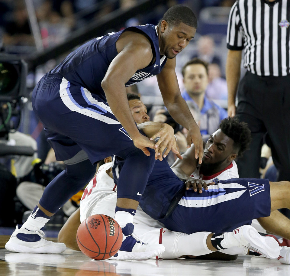 Photo - Oklahoma's Khadeem Lattin (12) fights for the ball with Villanova's Kris Jenkins (2), left, and Jalen Brunson (1) during the national semifinal between the Oklahoma Sooners (OU) and the Villanova Wildcats in the Final Four of the NCAA Men's Basketball Championship at NRG Stadium in Houston, Saturday, April 2, 2016. Photo by Nate Billings, The Oklahoman