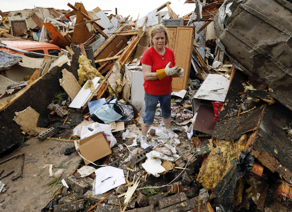 JoAnn Anderson sorts through the rubble of her home after a tornado near SW 149th and Western on Monday, May 20, 2013  in Moore, Okla. Photo by Steve Sisney, The Oklahoman