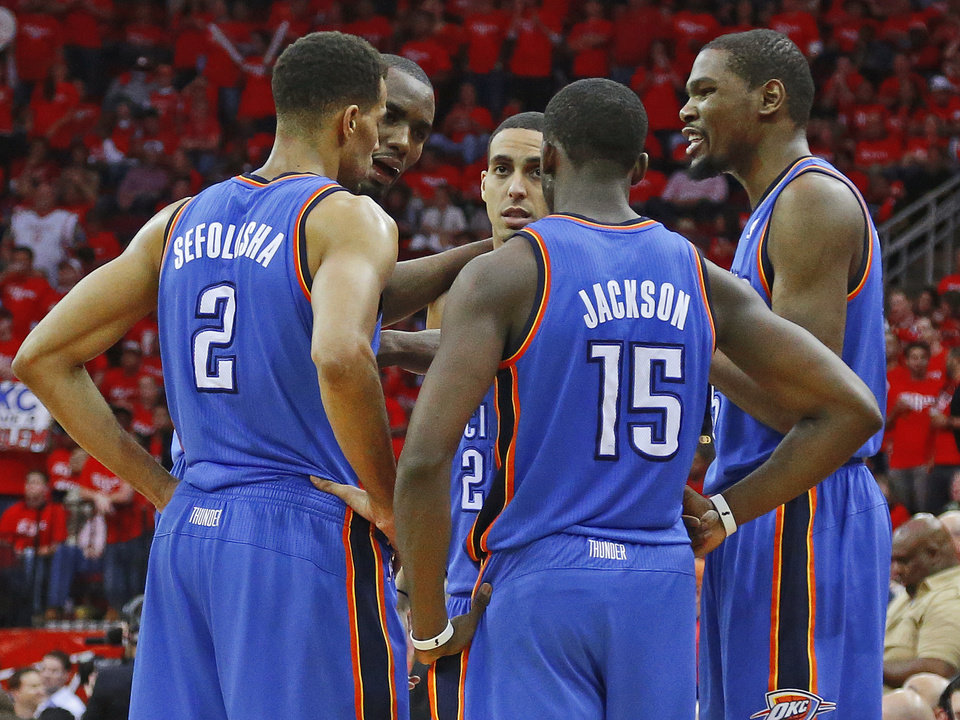 Oklahoma City's Thabo Sefolosha (2), Reggie Jackson (15), Kevin Durant (35). Serge Ibaka (9), second from left, and Kevin Martin (23), center, talk during a timeout in Game 6 in the first round of the NBA playoffs between the Oklahoma City Thunder and the Houston Rockets at the Toyota Center in Houston, Texas, Friday, May 3, 2013. Oklahoma City won 103-94. Photo by Bryan Terry, The Oklahoman
