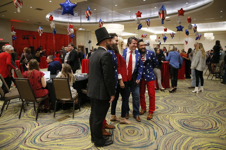 Photo - Supporters pose for a photo during a Republican Party election night watch party in Edmond, Tuesday, Nov. 3, 2020. [Bryan Terry/The Oklahoman]