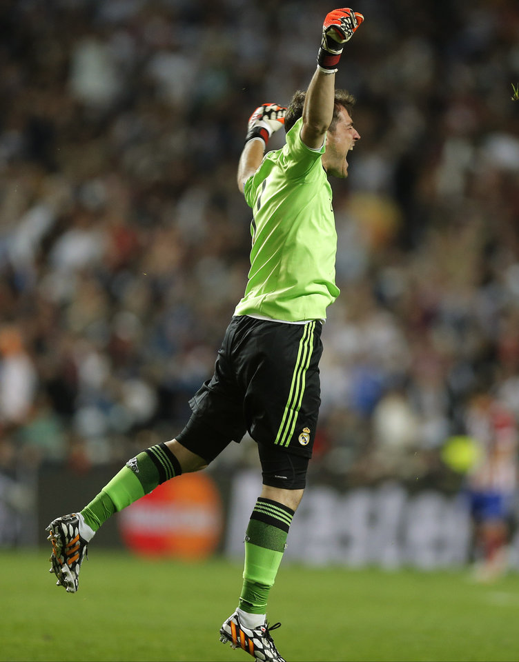Photo - Real goalkeeper Iker Casillas, reacts, after Real's Marcelo scores his side's 3rd goal, during the Champions League final soccer match between Atletico de Madrid and Real Madrid, at the Luz stadium, in Lisbon, Portugal, Saturday, May 24, 2014. (AP Photo/Daniel Ochoa de Olza)