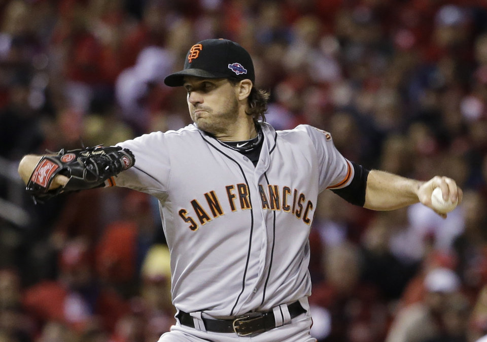 Photo -   San Francisco Giants starting pitcher Barry Zito throws during the first inning of Game 5 of baseball's National League championship series against the St. Louis Cardinals Friday, Oct. 19, 2012, in St. Louis. (AP Photo/David J. Phillip)