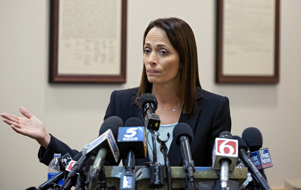 Photo -  Defense attorney Sabrina Strong speaks to the media after the verdict was announced in the opioid trial. [Chris Landsberger/The Oklahoman]