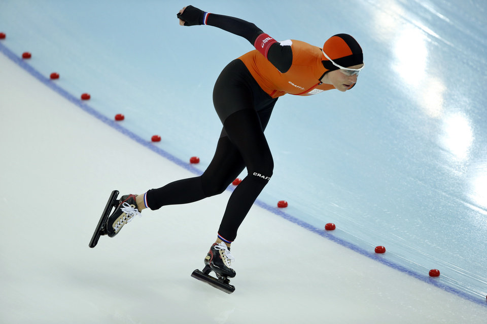 Photo - Carien Kleibeuker of the Netherlands competes in the women's 5,000-meter speedskating race at the Adler Arena Skating Center during the 2014 Winter Olympics In Sochi, Russia, Wednesday, Feb. 19, 2014. (AP Photo/Pavel Golovkin)