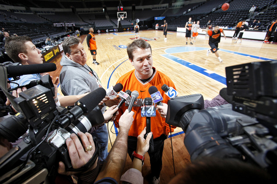 Photo - Barring a total collapse against Iowa State today and a snub by the NCAA Tournament committee, Travis Ford's first season at Oklahoma State could be considered a success. PHOTO BY CHRIS LANDSBERGER