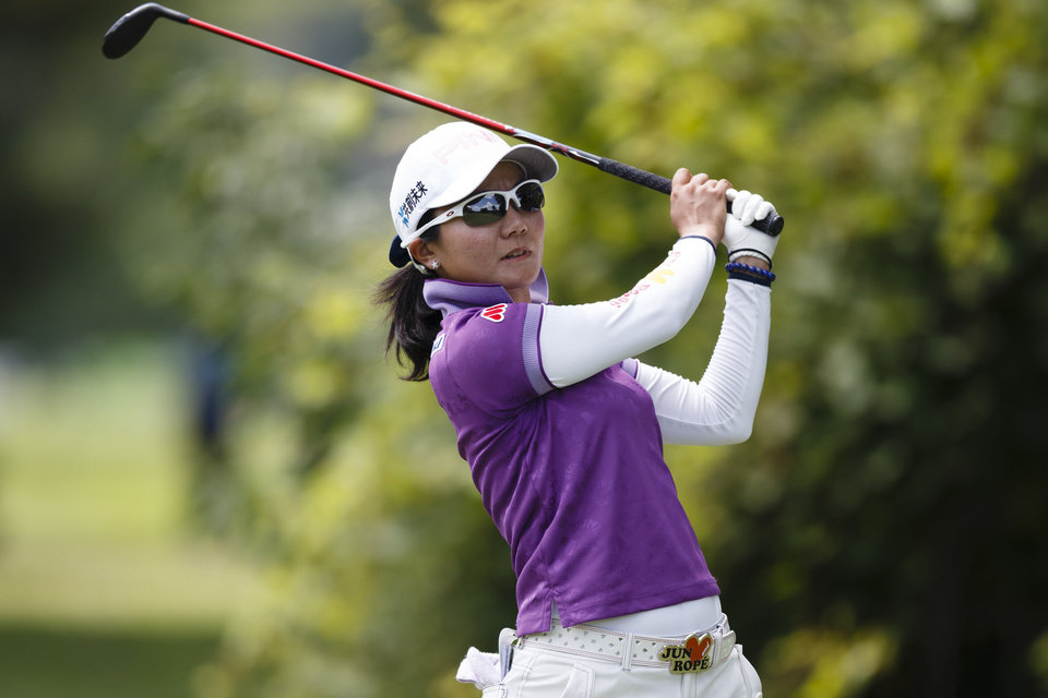 Photo - Ayako Uehara, of Japan, tees off on the second hole during the second round of the Marathon Classic LPGA golf tournament at Highland Meadows Golf Club in Sylvania, Ohio, Friday, July 19, 2013. (AP Photo/Rick Osentoski)