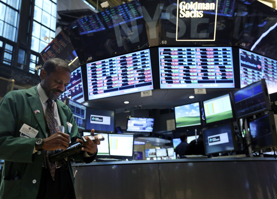 In this Thursday, Feb. 21, 2013, photo, a trader works on the floor of the New York Stock Exchange.  (AP Photo/Mary Altaffer)