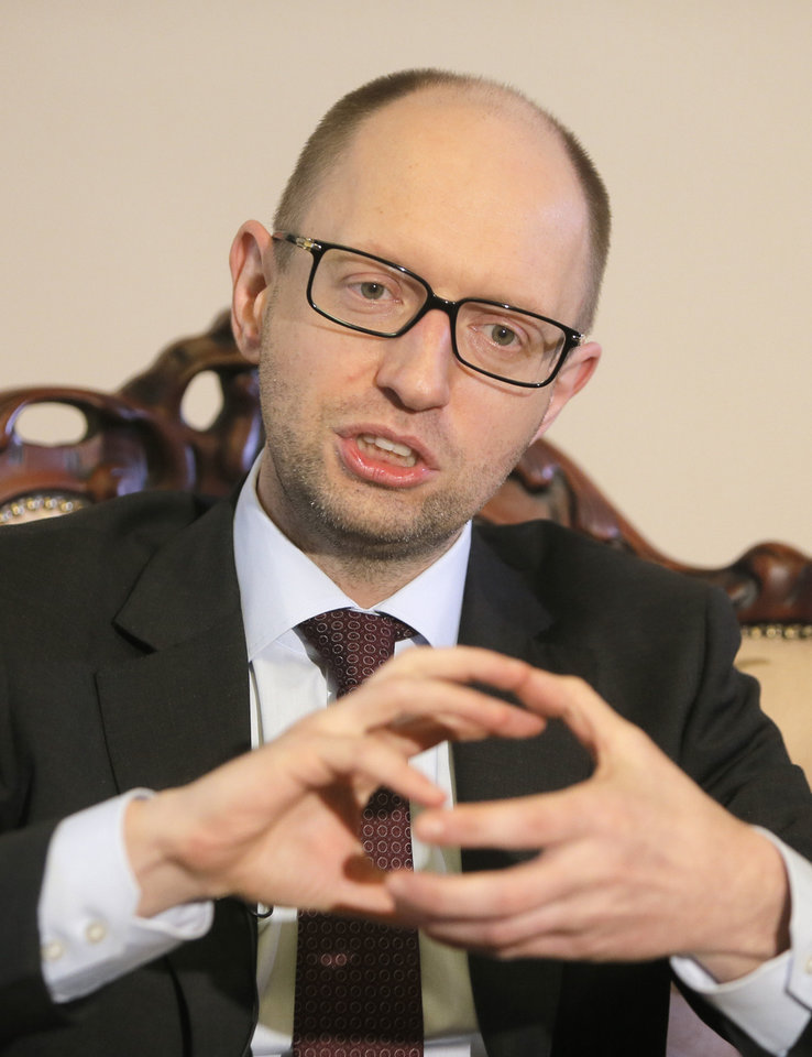 Photo - Ukrainian Prime Minister Arseniy Yatsenyuk talks with reporters during an interview with the Associated Press in Kiev, Ukraine, Wednesday March 5, 2014. Yatsenyuk said Wednesday that embattled Crimea must remain part of Ukraine, but may be granted more local powers. (AP Photo/Efrem Lukatsky)