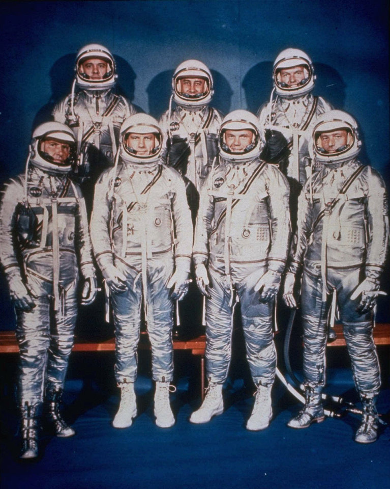 "Photo - Mercury astronauts: Here are the seven Project Mercury astronauts in their spacesuits in April 1959. They are: (front row, left to right) Walter H. ""Wally"" Schirra Jr., Donald K. ""Deke"" Slayton, John H. Glenn Jr. and Scott Carpenter; (back row, left to right) Alan B. Shepard Jr., Virgil I. ""Gus"" Grisson and Leroy Gordon Cooper. (Photo by NASA)"