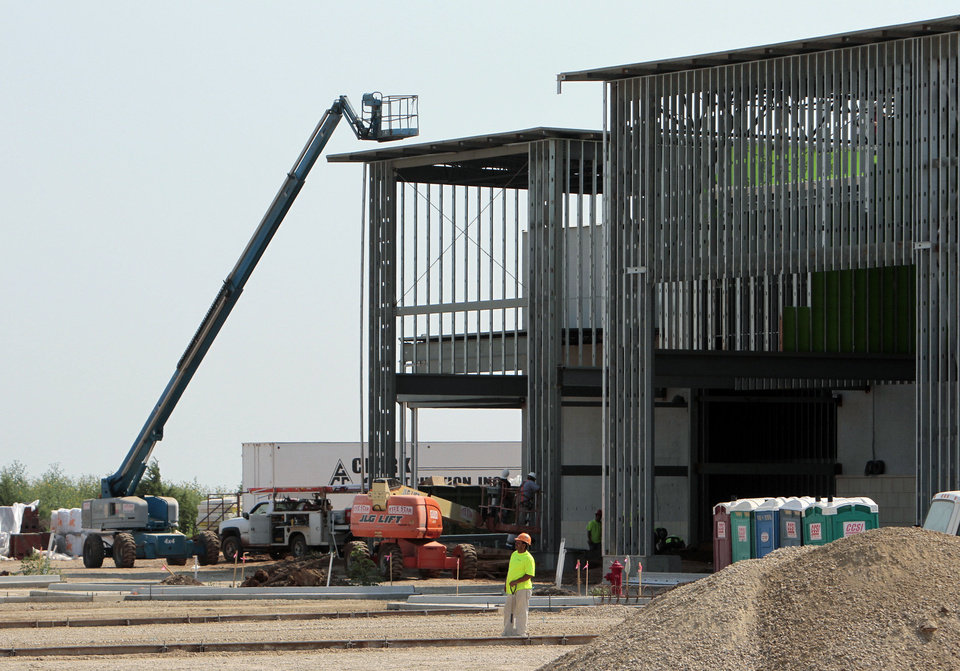 Photo - Crest Foods and other new retail sites are under construction in the University North Park area on Wednesday, Aug. 21, 2013 in Norman, Okla.  Photo by Steve Sisney, The Oklahoman