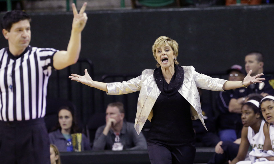 Photo - Baylor head coach Kim Mulkey, right, reacts to a call by referee Roy Gulbeyan during the first half of an NCAA college basketball game against Oklahoma, Monday, Feb. 24, 2014, in Waco, Texas. (AP Photo/LM Otero)