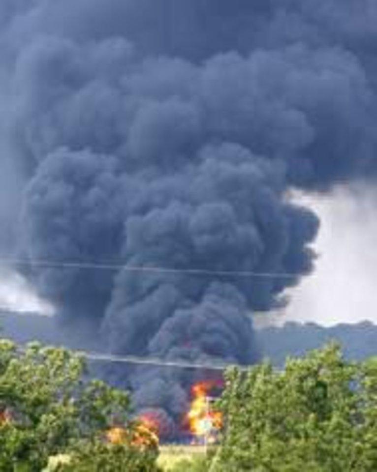 Photo - Flames and smoke billow out of a train derailment Aug. 22, 2008, in Luther. OKLAHOMAN ARCHIVES PHOTO