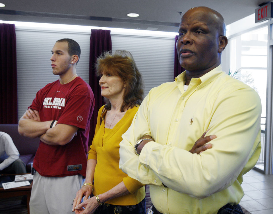 Taylor, Gail and Tommy Griffin watch as their brother/son, University of Oklahoma basketball star Blake Griffin, announces he will leave the Sooner team for the professional draft in Norman, Okla. on Tuesday, April 7, 2009.   