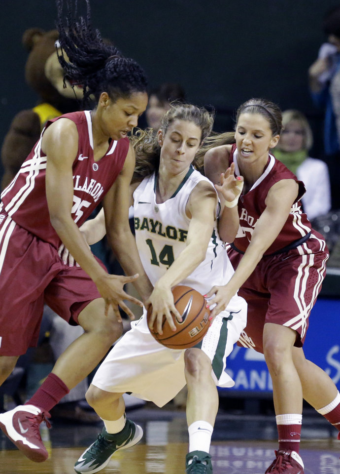 Photo - Oklahoma guards Gioya Carter, left, and Morgan Hook, right, trap Baylor guard Makenzie Robertson (14) as they reach for the ball during the first half of an NCAA college basketball gam,e Monday, Feb. 24, 2014, in Waco, Texas. (AP Photo/LM Otero)