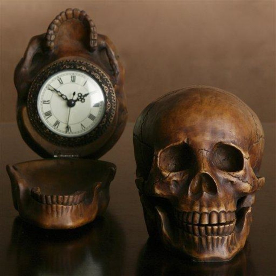 Photo - This product image released by Z Gallerie shows their wood-finish, resin-hinged skull that holds a clock. This season you'll find lots of ghoulish yet glamorous pieces to decorate with for Halloween.   (AP Photo/Z Gallerie)